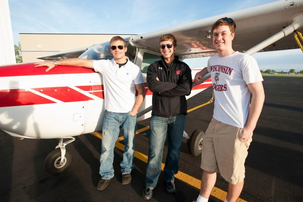 On April 26, 2010, University of Wisconsin-Madison undergraduates and members of the Flying Badgers aviation club Shawn Willette (left), Jason Muth (center) and Gregory Oudheusden (right) stand next to a single-propeller plane at the Dane County Regional Airport in Madison, Wisconsin. Oudheusden is the president and founder of the club. Willette has a license to be a private pilot, and friends in the club have drawn Muth to aviation. ©UW-Madison University Communications 608/262-0067 Photo by: Bryce Richter Date: 04/10 File#: NIKON D3 digital frame 1868